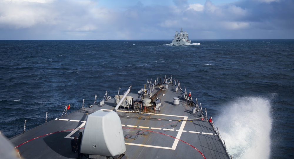 The Arleigh Burke-class guided-missile destroyer USS Donald Cook (DDG 75) approaches the Royal Fleet Auxiliary Tide-class replenishment tanker Tidesurge (A138) for a refueling at sea, Oct. 18, 2019.