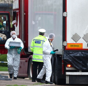 Police at the scene where bodies were discovered in a lorry in Grays, Essex on 23 October 2019