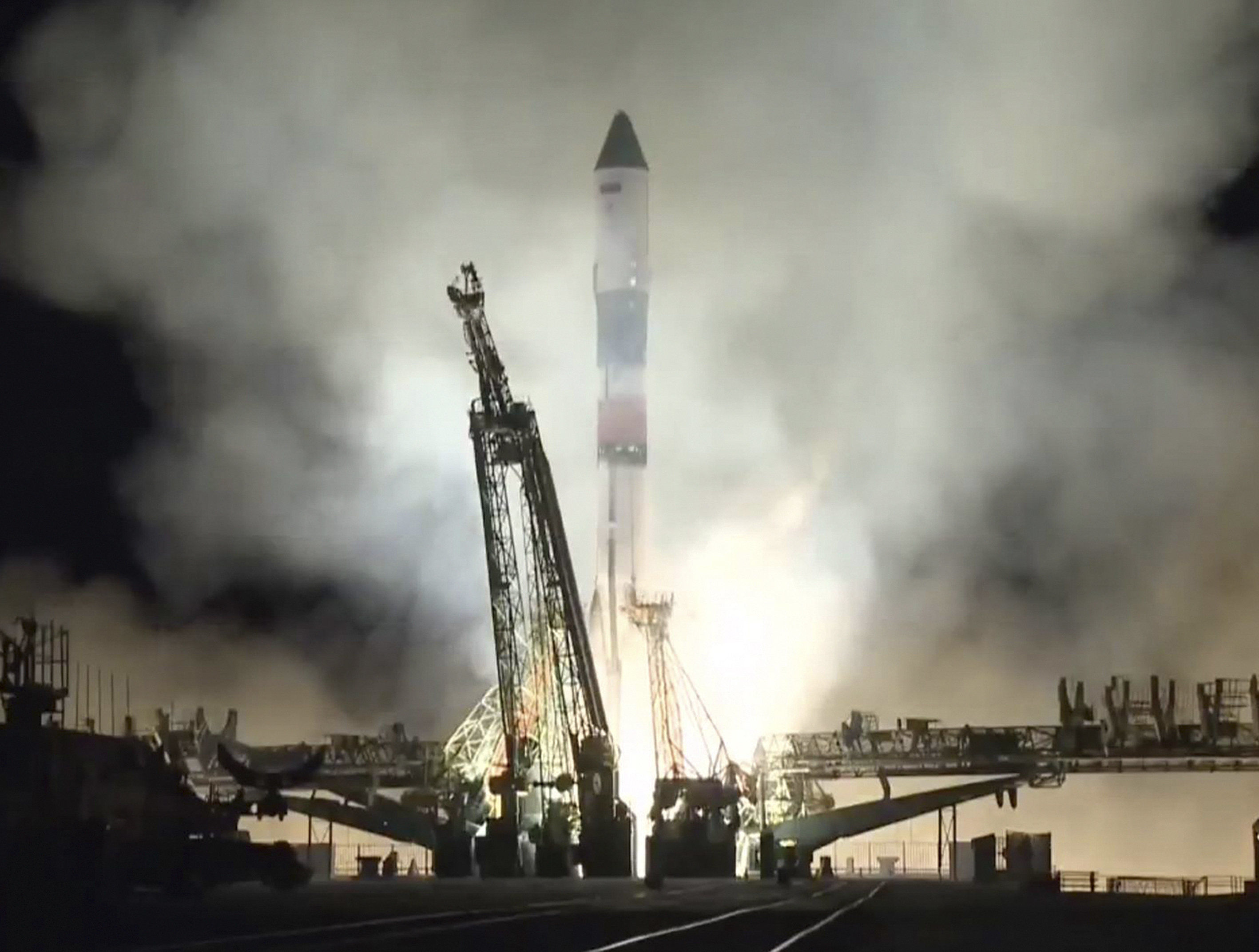 In this photo distributed by Roscosmos Space Agency Press Service on Friday, Nov. 16, 2018, Russian cargo ship Souz FG with the Progress MS-10 takes off from the launch pad at Russia's main space facility in Baikonur, Kazakhstan