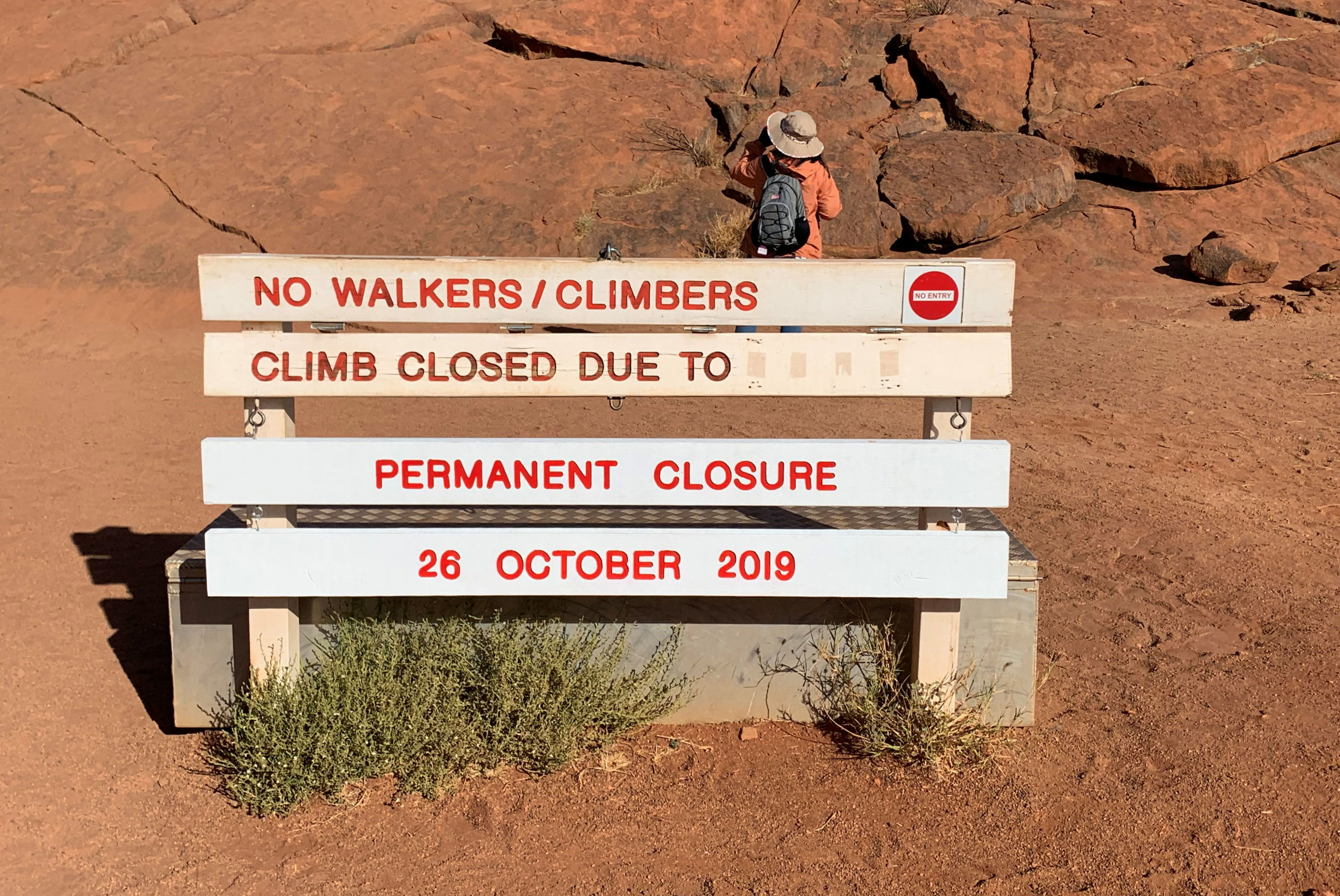 A new permanent closure sign is installed at Uluru, formerly known as Ayers Rock, the day before a permanent ban on climbing the monolith takes effect following a decades-long fight by indigenous people to close the trek, near Yulara, Australia
