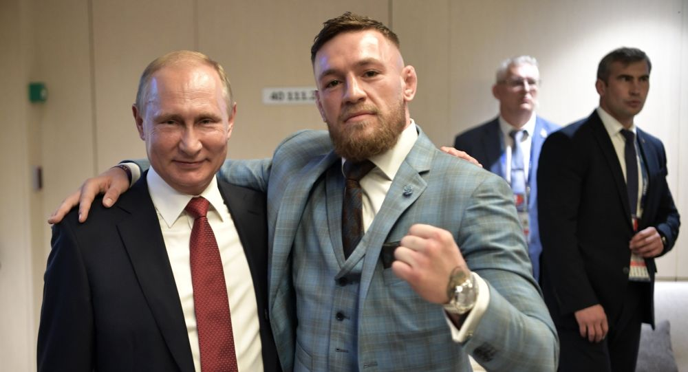 Russian President Vladimir Putin and Irish mixed martial artist Conor McGregor, right, during the break in the 2018 FIFA World Cup final match between the national teams of France and Croatia at Luzhniki Stadium