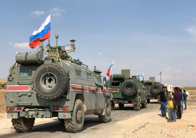 A Russian military police armored vehicles are pictured in the Syrian-Turkish border town of Kobani, Syria