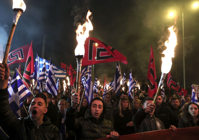 Supporters of Greece's Golden Dawn raise torches during a rally commemorating a 1996 military incident which cost the lives of three Greek navy officers and brought Greece and Turkey to the brink of war, in Athens, on Saturday, Feb. 2, 2019