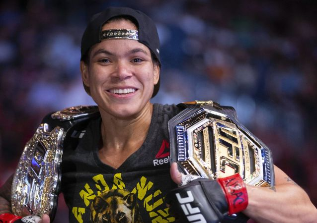 Amanda Nunes smiles after victory over Holly Holm during their women's bantamweight mixed martial arts title bout at UFC 239 on Saturday, July 6, 2019, in Las Vegas