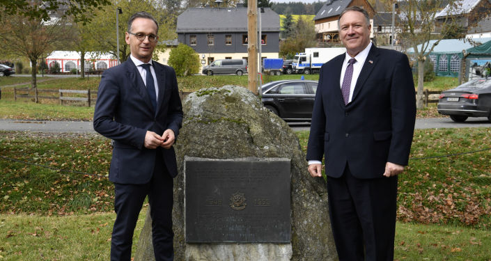 German Foreign Minister Heiko Maas and U.S. Secretary of State Mike Pompeo pose next to a memorial stone In honor of the 2d Armored Cavalry Regiment soldiers who patrolled along the Iron Curtain to protect freedom and peace in Western Europe during their visit to the village of Moedlareuth near Hof, Germany November 7, 2019