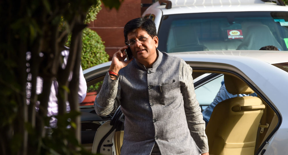 Indian minister of Railways and Commerce and Industry Piyush Goyal talks on the phone as he arrives to attend a meeting with the newly-named cabinet in New Delhi on May 31, 2019