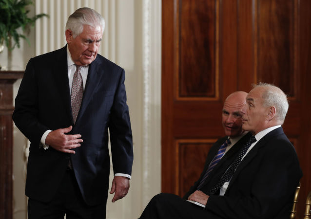 Secretary of State Rex Tillerson arrives to sit in the front row with national security adviser H.R. McMaster, center and White House Chief of Staff John Kelly