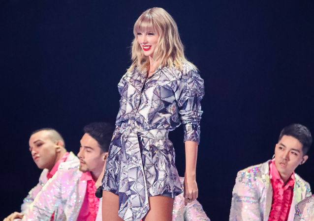 US singer Taylor Swift (C) performs during the 2019 Tmall 11:11 Global Shopping Festival gala in Shanghai on November 10, 2019