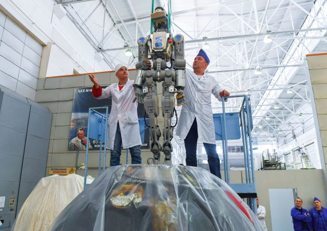 Workers of the Space Corporation Energia remove the anthropomorphic Skybot F-850 robot FEDOR from the Soyuz MS-14 space ship capsule after its return from International Space Station (ISS), in Korolev, outside Moscow, Russia
