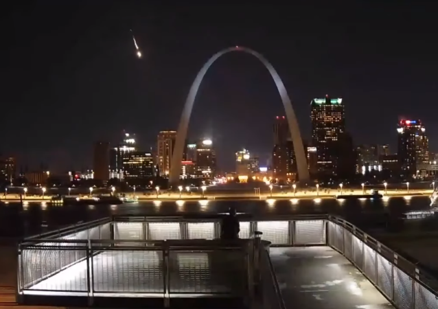 Earthcam footage captures the moment in which a fireball streaks across the Missouri nighttime sky near St. Louis' Gateway Arch.