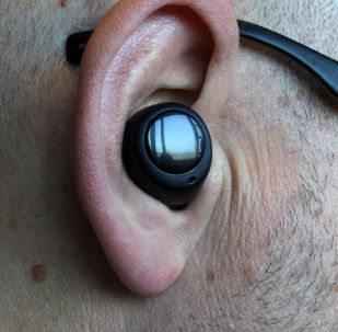 A man wears Alexa-infused wireless Echo earbuds that will synch with smartphones at Amazon's headquarters in Seattle on September 25, 2019