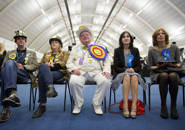Monster Raving Loony Party candidate, Alan Howling Laud Hope (centre) at the count in Boris Johnson's seat, Uxbridge, in 2015