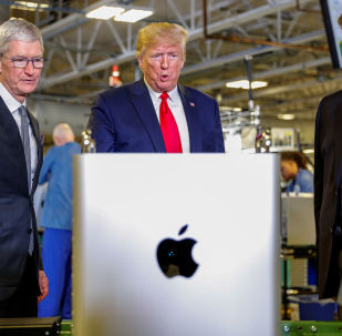 Apple CEO Tim Cook escorts U.S. President Donald Trump as he tours Apple's Mac Pro manufacturing plant with in Austin, Texas, U.S., November 20, 2019