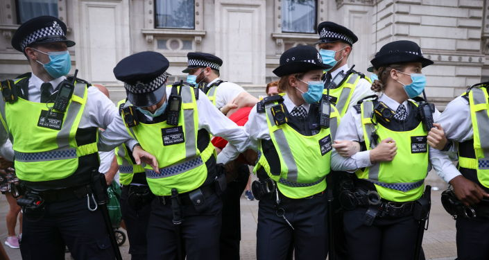 UK Police Charged Man Over Abusive Behaviour Towards BBC Journalist at Covid Protest
