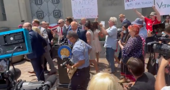 Watch: US Reps. Gaetz, MTG Flee 1/6 Commission Presser After It's Swamped by Protesters
