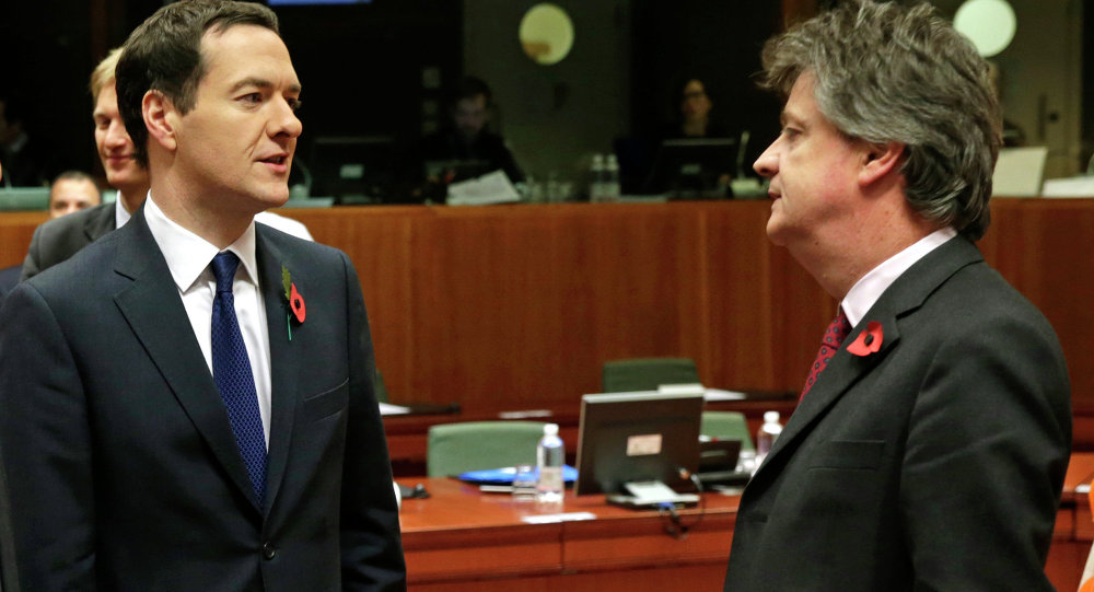 British Chancellor of the Exchequer George Osborne, left, talks with European Commissioner for Financial Stability and Financial Services Jonathan Hill