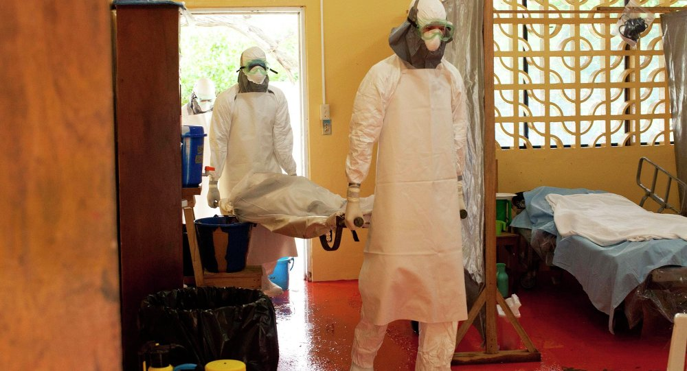 Doctors are carrying a patient infected with the Ebola virus in Monrovia hospital, Liberia, West Africa.