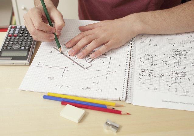 Close up of teenager doing math's homework