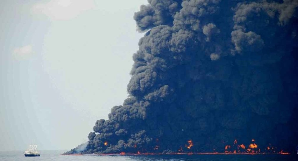 This June 22, 2010 photo shows response crews gathering and burning oil in the Gulf of Mexico near the site of the leaking Macondo Prospect oil field well.
