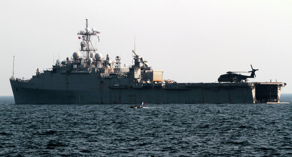 French speedboat deployed from the back of the USS Ponce in the Persian Gulf passes by the U.S. Navy's floating base