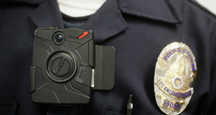 a Los Angeles Police officer wears an on-body camera during a demonstration for media in Los Angeles. Mayor Eric Garcetti will unveil a plan Tuesday, Dec. 16, 2014, to equip every officer on the Los Angeles police force with an on-body camera. The department has been field testing body cameras on a small number of its 9,900 officers. Nationally, about one in six officers has been outfitted with a body camera.