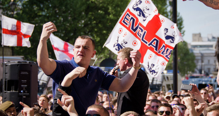 A supporter of the far-right English Defence League (EDL) gestures near Downing Street in central London