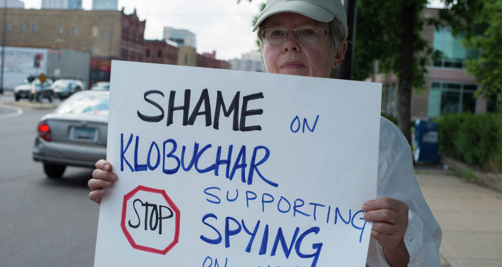 An anti-NSA spying activist protests Sen. Amy Klobuchar in Minneapolis. Klobuchar, who represents Minnesota, defended the NSA's collection of millions of phone records arguing they were not eavesdropping.
