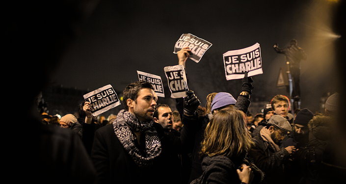People holding placards reading 'Je Suis Charlie' (I am Charlie) during a three-million people gathering that swamped the streets of Paris in support for of victims of the terrorist attack at French newspaper Charlie Hebdo.