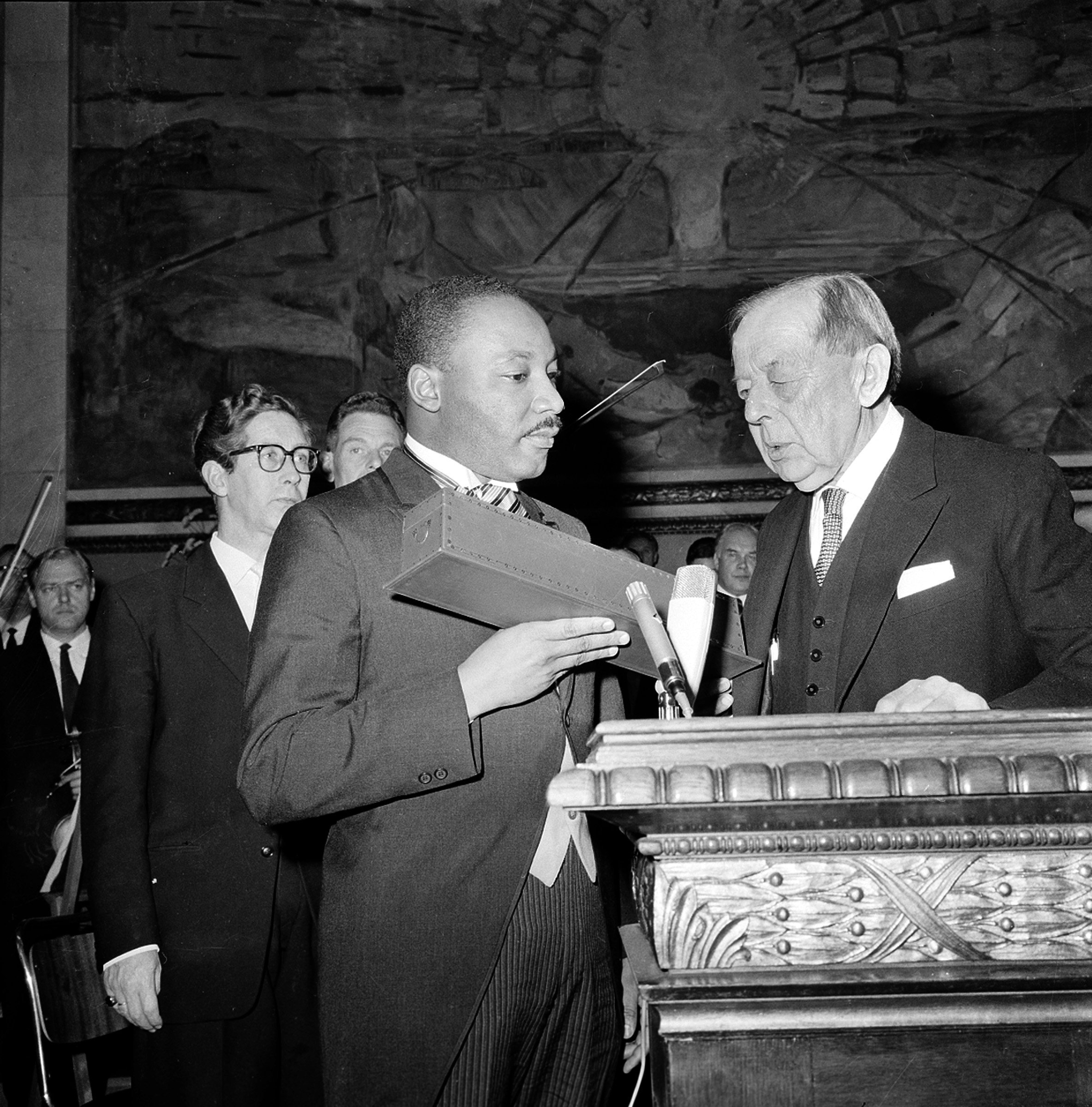 Dr. Martin Luther King Jr. receives Nobel Peace prize from Gunnar Jahn, the chairman of the Nobel Committee in Oslo, Norway in 1964