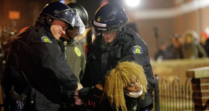 Police officers take a protester into custody Tuesday, Nov. 25, 2014, in Ferguson