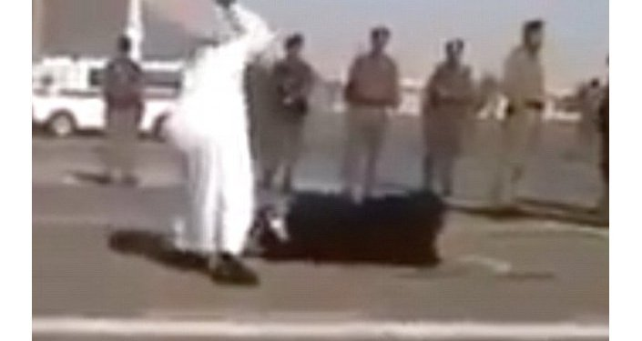 Screenshot of video leaked from Saudi Arabia showing the beheading of a woman accused of beating her daughter to death.