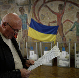 A man with ballots during an early election of deputies to Ukraine's parliament at a polling station in Kiev