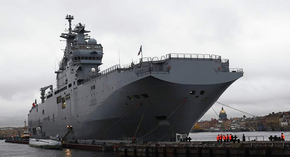 The European Parliament welcomed France's decision to postpone the delivery of Mistral-class helicopter carriers to Russia