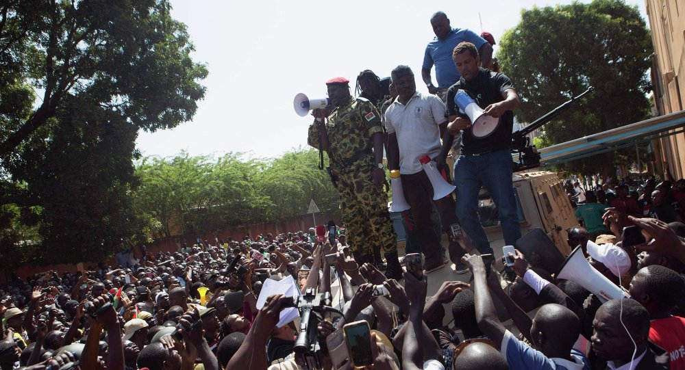 Lieutenant Colonel Yacouba Isaac Zida of Burkina Faso's presidential guard speaks to anti-government protesters in front of army headquarters in Ouagadougou, capital of Burkina Faso.