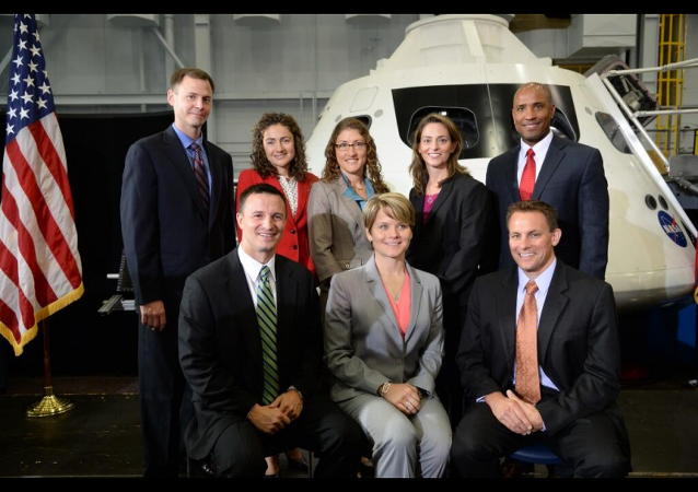 Members of NASA's newest astronaut class pose with an Orion capsule at NASA's space center in Houston on Tuesday.