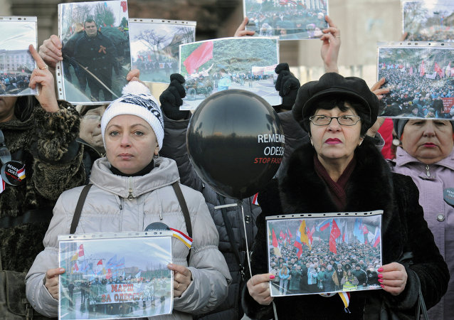 Odessa residents during mourning actions at the building of the Trade Unions Building on the square Kulikovo field in Odessa