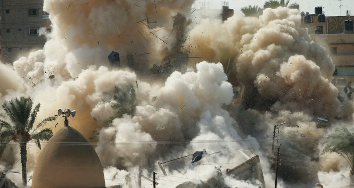 Smoke rises after a house is blown up during a military operation by Egyptian security forces in the Egyptian city of Rafah, near the border with southern Gaza Strip October 29, 2014. At least 33 Egyptian security personnel were killed on Friday in the Sinai Peninsula bordering Israel and Gaza, in an attack on a checkpoint that bore the marks of assaults claimed by Egypt's most active militant group Ansar Bayt al-Maqdis