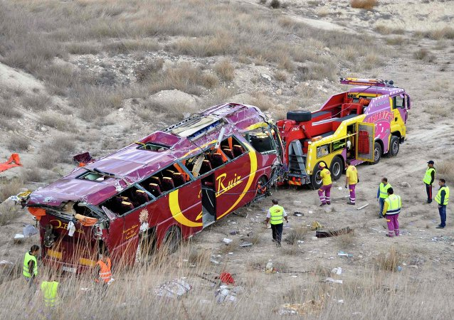Emergency services attend to the scene of a bus crash in Ciez, near Murcia