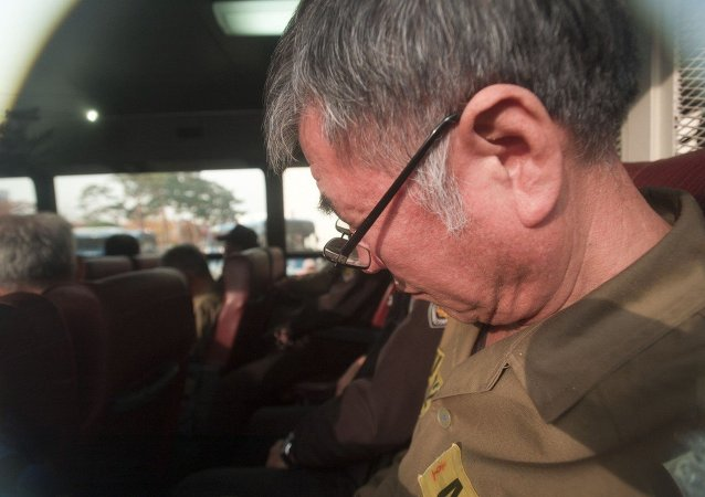 Lee Joon-seok, the captain of the sunken South Korean ferry Sewol, on the bus, arrives for verdict and sentence session at Gwangju District Court in Gwangju, South Korea, Tuesday, Nov. 11, 2014