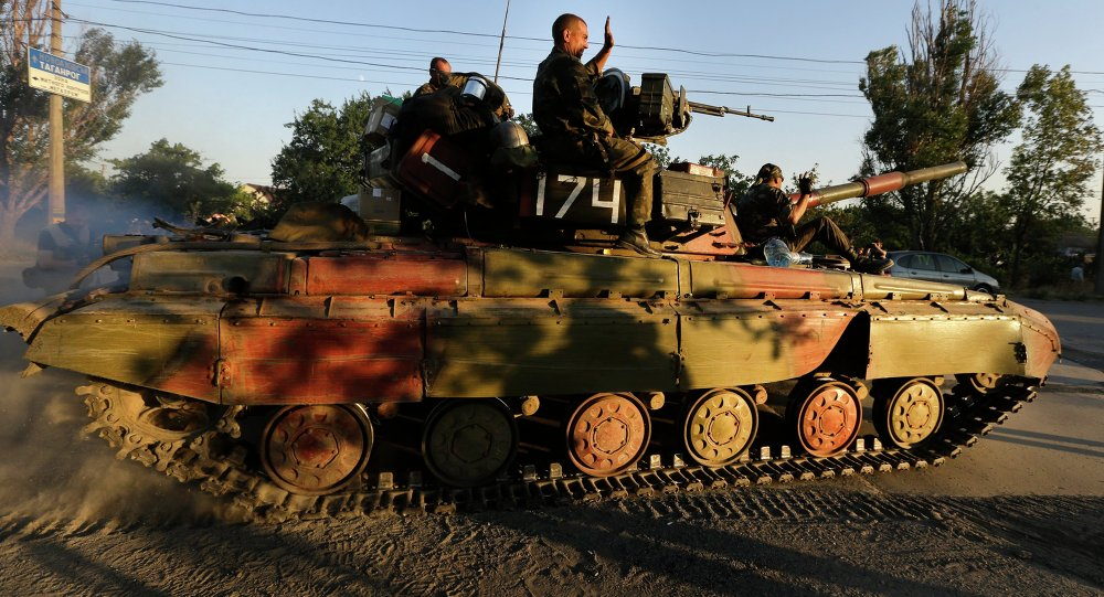 Soldiers of Ukrainian army ride on a tank in the port city of Mariupol, southeastern Ukraine, Friday, Sept. 5, 2014