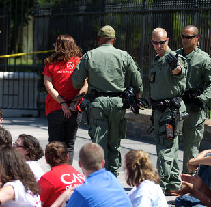 Demonstrators are arrested outside the White House in Washington on Thursday, Aug. 28, 2014 during a rally calling for President Barack Obama to stop deportations of migrants