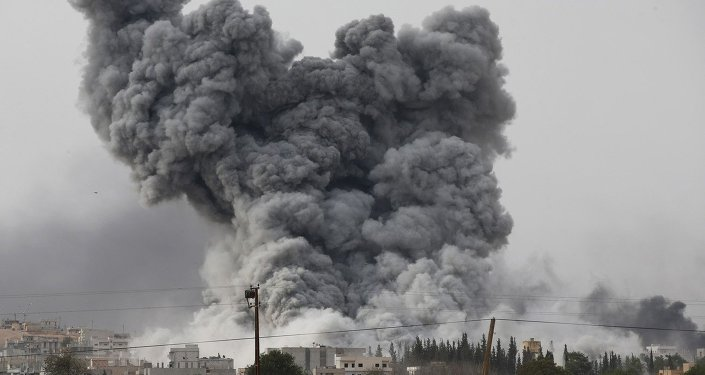 Thick smoke rises following an airstrike by the US-led coalition in Kobani, Syria as fighting intensified between Syrian Kurds and the militants of Islamic State group, as seen from Mursitpinar in the outskirts of Suruc, at the Turkey-Syria border, Sunday, Oct. 12, 2014.