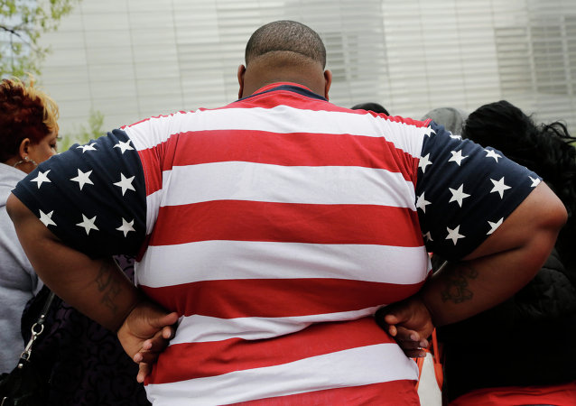Overweight man wears a shirt patterned after the American flag