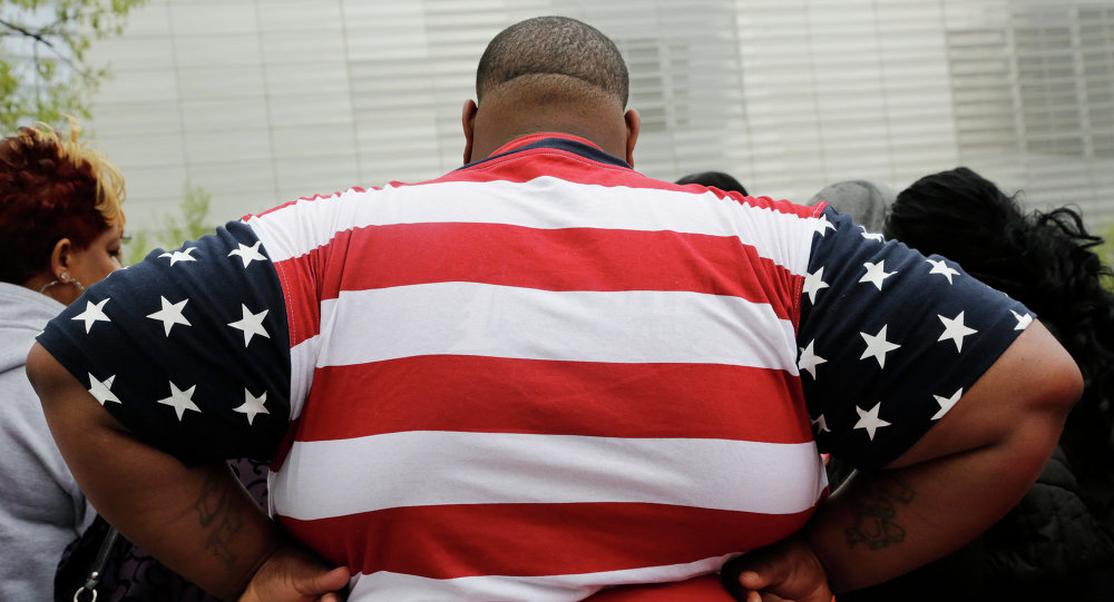 Overweight man wears a shirt patterned after the American flag during a visit to the World Trade Center, in New York