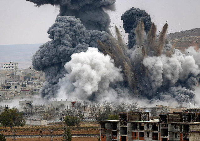 Smoke rises from the Syrian city of Kobani
