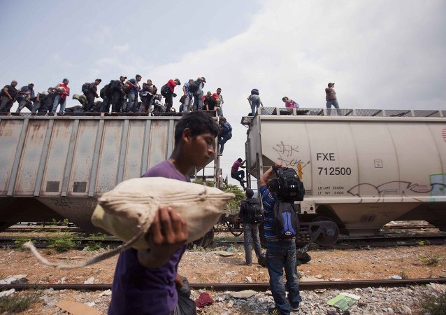 Migrants coming from Central America climb off a train during their journey toward the U.S.-Mexico border in Ixtepec, Mexico, Monday, April 29, 2013