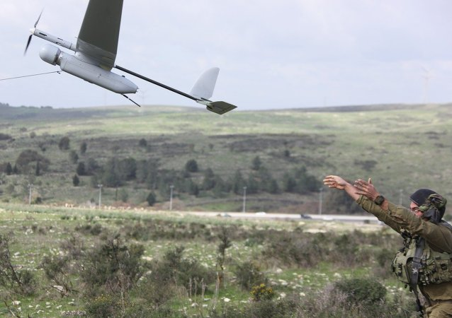 An Israeli soldier launches the Skylark drone during a drill near Bat Shlomo