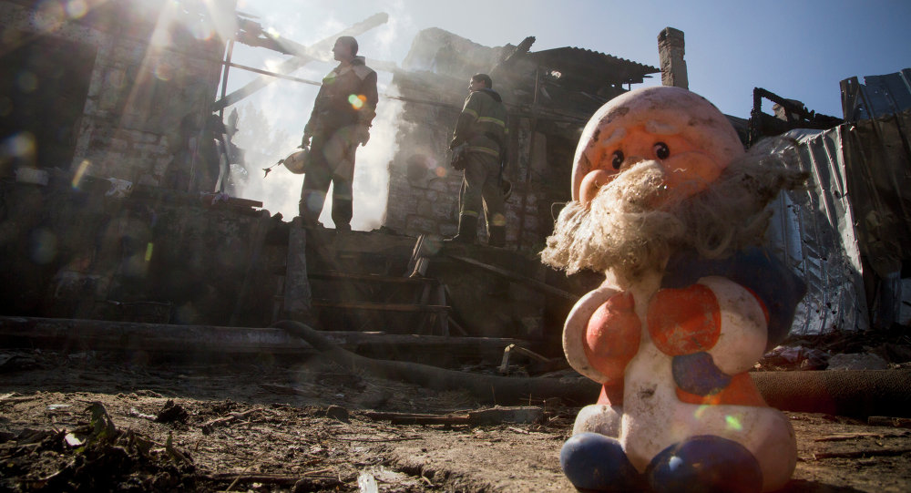 Firefighters inspect a burned house after shelling in the town of Donetsk, eastern Ukraine, Friday, Oct. 10, 2014