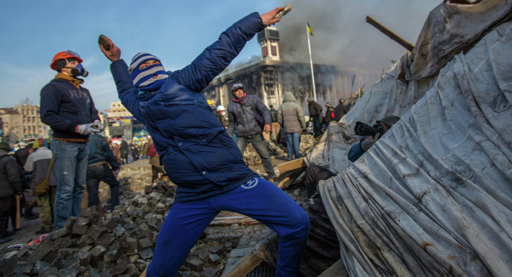 A protester throws stone on Maidan square in Kiev, Ukraine, Feb 19, 2014