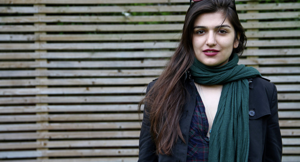 This 2012 photo provided by the Free Ghoncheh Campaign, shows Iranian-British Ghoncheh Ghavami posing for a photograph in London, England